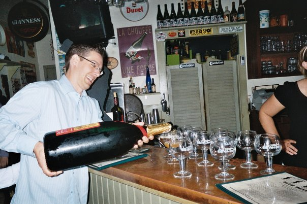 steve pouring from a big bottle - sharing with friends